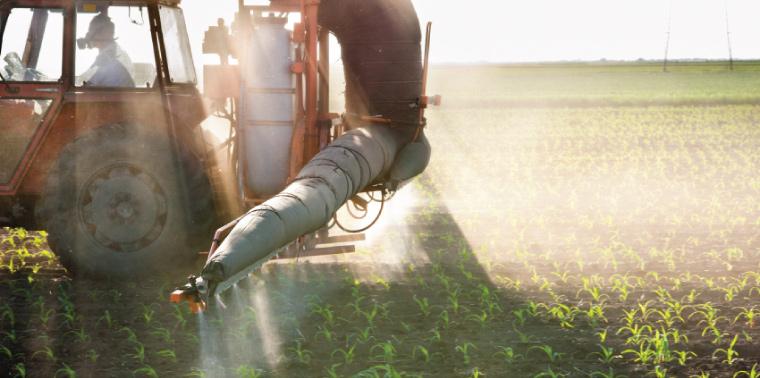 Tractor fertilizing crops