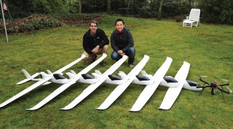 Serge Wich and Lian Pin Koh with a fleet of conservation drones.