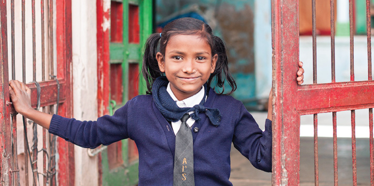 School girl at the entrance of her home in Dungarpur, Rajasthan
