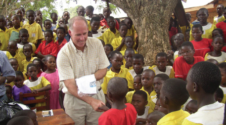 Greg Allgood with students in Africa