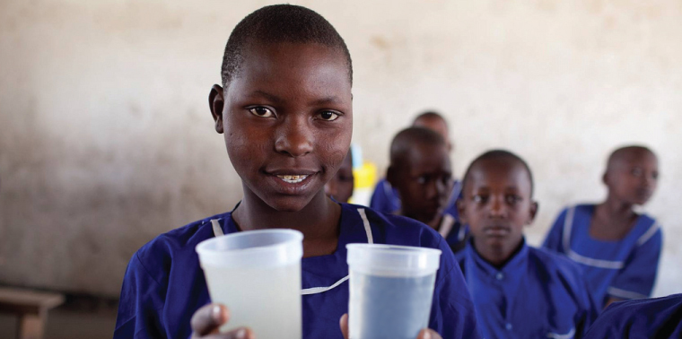 African girl with cups of water