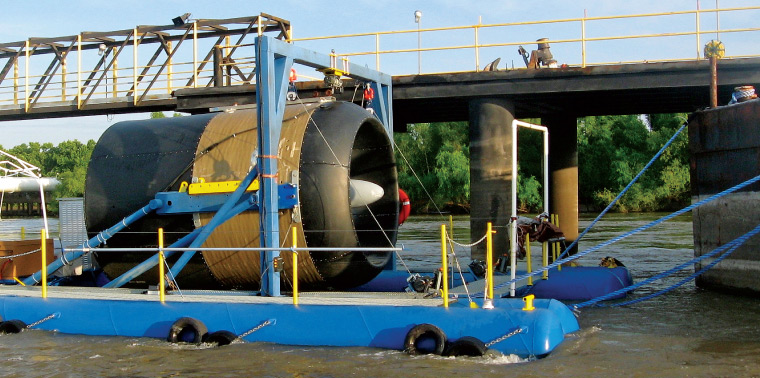 Hydrokinetic turbine generator being lowered into the Mississippi River