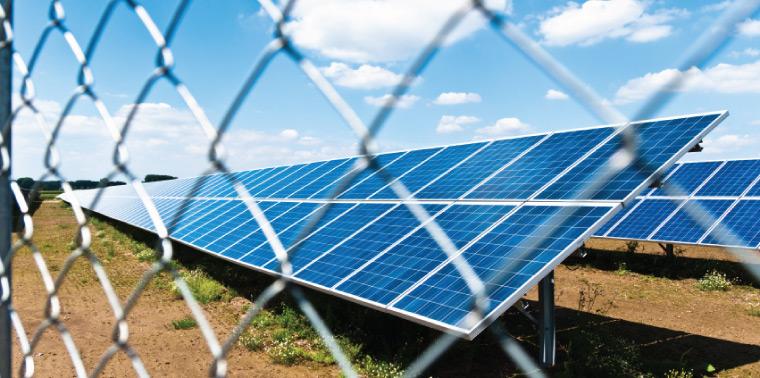 Solar panels behind fence