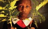 Kenyan girl holding plant seedlings