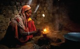 Woman using cook stove