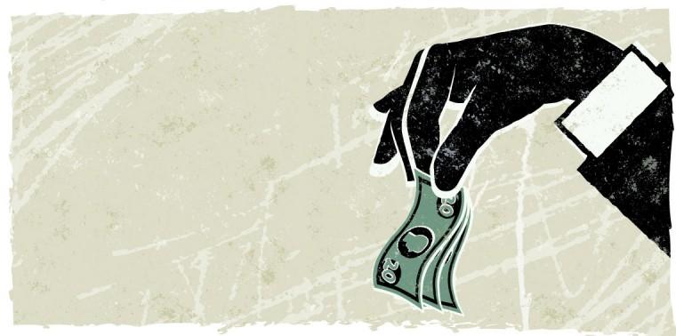 Hand dangling money