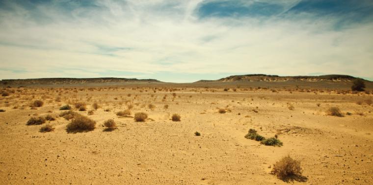 Distant mountain range in Libyan Sahara desert
