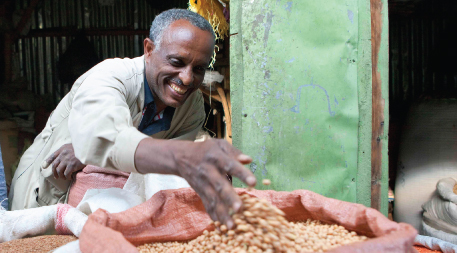Gebeyehu Melesse who sells chickpea at a market in Addis Ababa says that more people are buying new kabuli varieties.