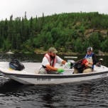 Researchers in boat on lake