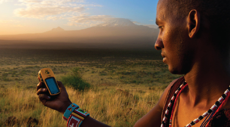 Guardian Ng'ida takes a GPS point in front of Mt. Kilimanjaro