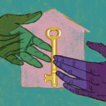 Hands exchanging a key in front of a house symbolizing community