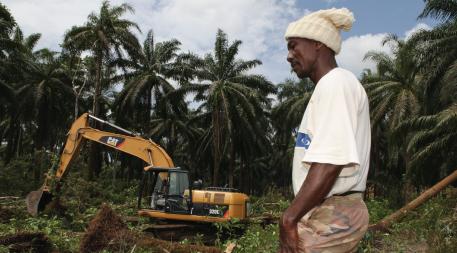 Man standing near excavator