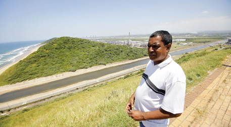 Desmond D'Sa surveying the area that will be affected by the proposed expansion of the Port of Durban, South Africa