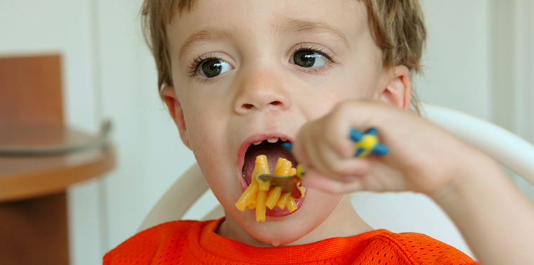 Child eating macaroni and cheese