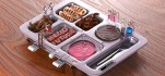Futuristic cafeteria tray with meat printer, crickets, chicken-free strips, mealworms and test tube burger