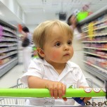 Child in shopping cart with blurred background
