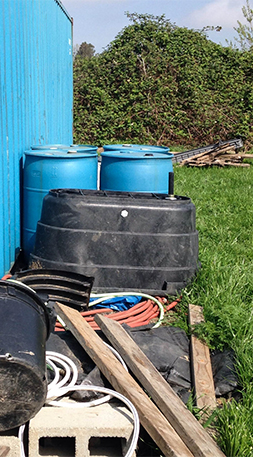 Plastic buckets and barrels at Vibrant Valley Farm