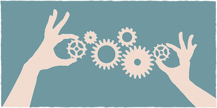 Hands aligning cogs and gears