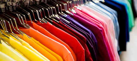 A rainbow of clothing produced using colored dyes.