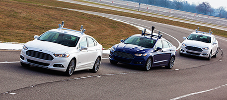 "Automated vehicles can boost fuel efficiency by ""platooning,"" or following each other closely. Photo of automated Ford Fusion Hybrid research vehicles courtesy of the Ford Motor Company Media Center."
