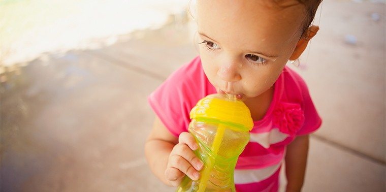 Girl with sippy cup