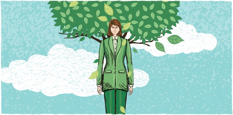 Business woman in front of tree growth