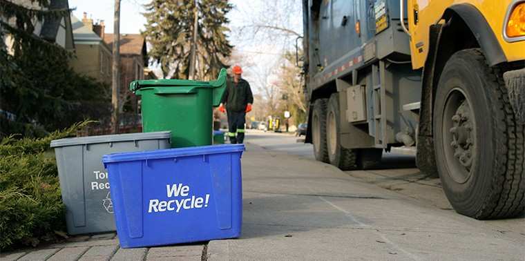 Curbside recycling bin and recycling truck