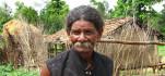 Village elder narrating his tales of woe