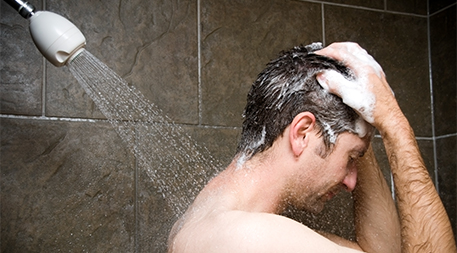 Man using shampoo