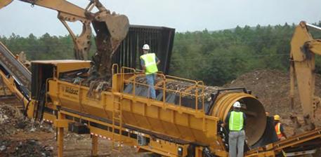 sorting material at Perdido landfill