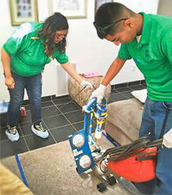 Members of the CHAMACOS Youth Council collect dust samples from homes involved in their study.