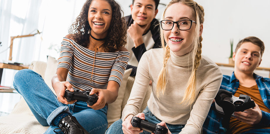 Photo of teenagers playing video games