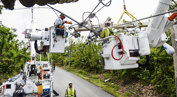 Workers repairing electrical grid in Puerto Rico after Hurricane Maria