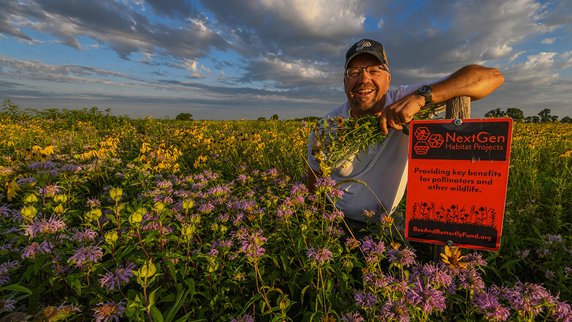 Peter Berthelsen standing among wildflowers