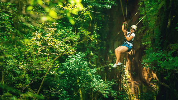 ziplining tourist in Costa Rica