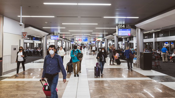 airport with masked travelers