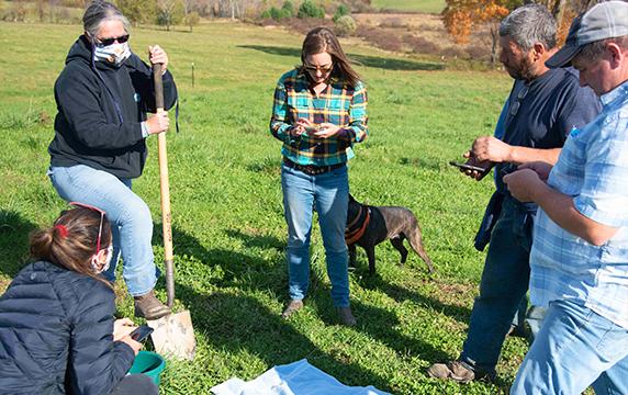 Selena Brown digs a soil sample