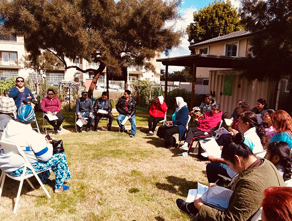 Circle of residents is a Community Organizing Event at West Athens Victory Garden in South LA.
