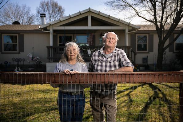 Cheryl and Edward Blackhawk outside their home in El Adobe, California.