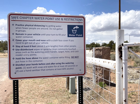 sign outside the Chi Chil Tah Chapter House explains how to safely fill water containers during the COVID-19 pandemic