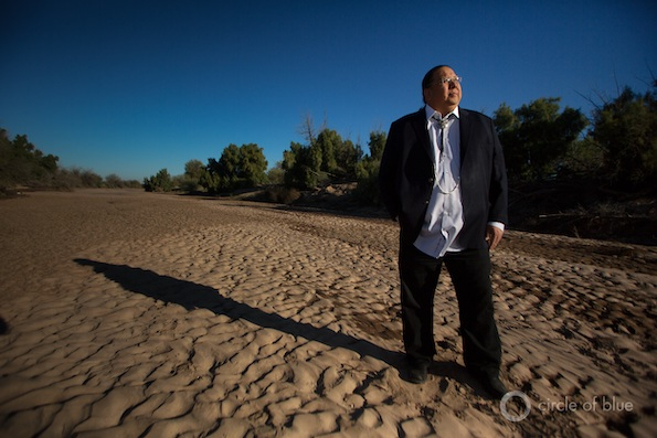 Governor Stephen Roe Lewis, leader of the Gila River Indian Community, stands in the dry bed of the Gila River, outside of Sacaton, Arizona. Photo © J. Carl Ganter / Circle of Blue